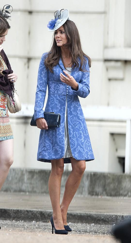 Kate wore a stunning blue patterned Jane Troughtoncoat to a friend's wedding, paired with a Jane Corbett fascinator and black court shoes.