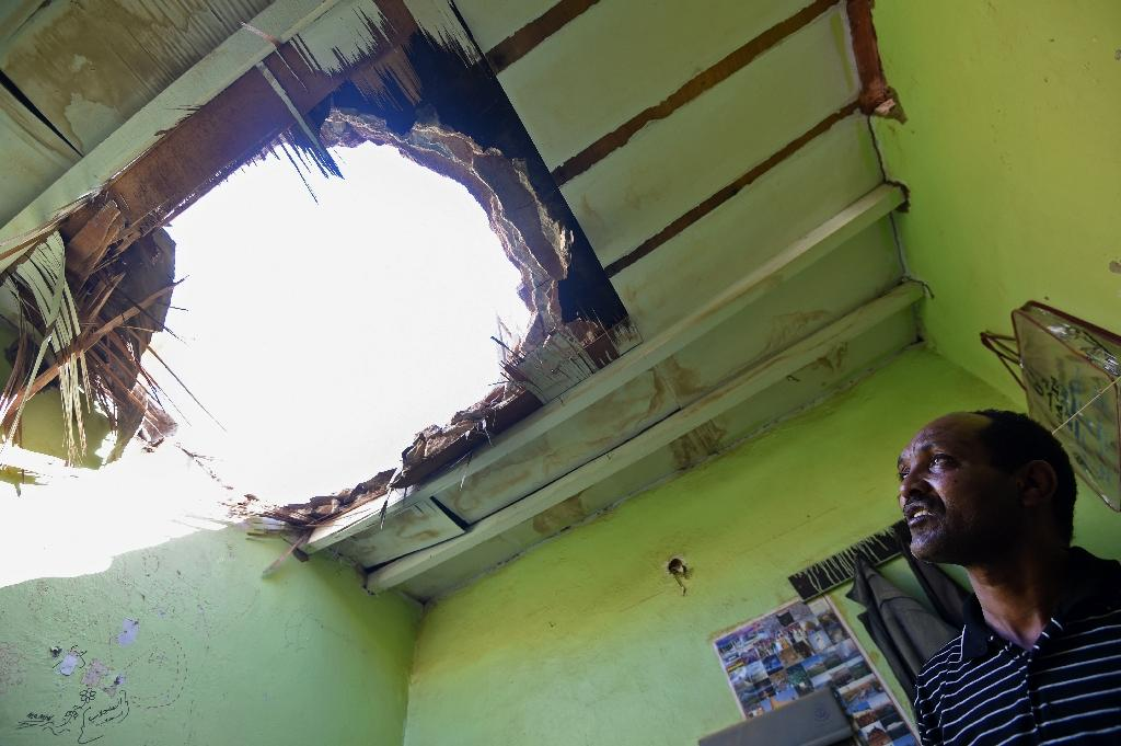 The hole left in the ceiling of a home in Riyadh caused by debris from falling shrapnel from Yemeni rebel missiles that were intercepted over the Saudi capital in March (AFP Photo/FAYEZ NURELDINE)