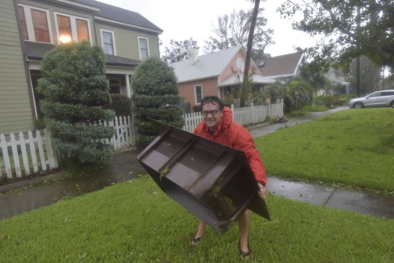 Don Boyd surveys storm damage from Hurricane Sally at his home in Pensacola