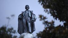 Crowds watch slavery advocate's statue removal