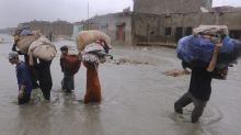 Flash floods triggered by rain kill 15 people in NW Pakistan