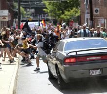 Charlottesville: Video captures moment counter-protester breaks leg pushing his fiancee out of path of car