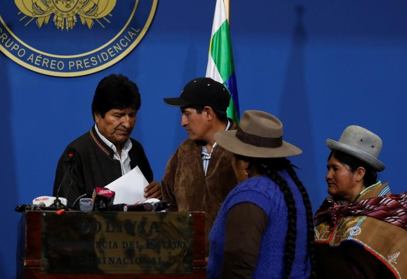 Bolivia's President Evo Morales looks on after adressing the media at the presidential hangar in the Bolivian Air Force terminal in El Alto