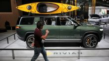 Electric vehicle startup Rivian gets a jolt from big Amazon.com van order
