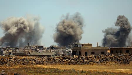 Smoke rises from al-Harak town, as seen from Deraa countryside, Syria June 25, 2018. REUTERS/Alaa al-Faqir