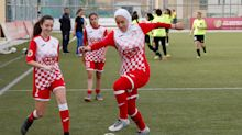 Soccer players help hijab-wearing opponent in faith-restoring act of sportsmanship