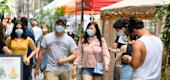 People wear protective face masks in New York City. (Getty Images)
