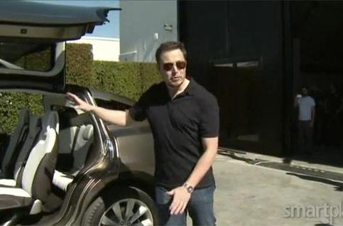 Tesla's Model X struts its stuff on video, gets serenaded by Elon Musk