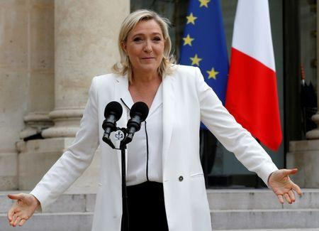 Marine Le Pen, France's far-right National Front political party leader, talks to journalists following a meeting with the French President after Britain's vote to leave the European Union, at the Elysee Palace in Paris