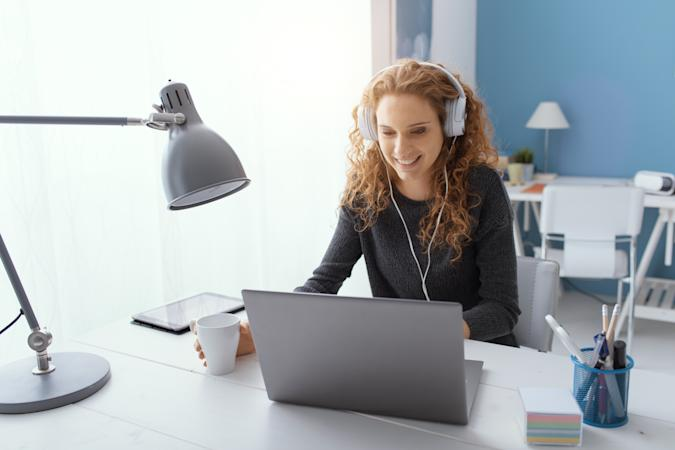 Happy girl watching movies online