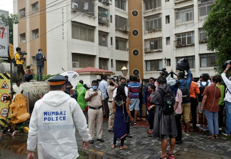 Police officers arrive to clear media personnel from the gate of the residence of Bollywood actor Rhea Chakraborty before she leaves her home for CBI office for questioning, in Mumbai