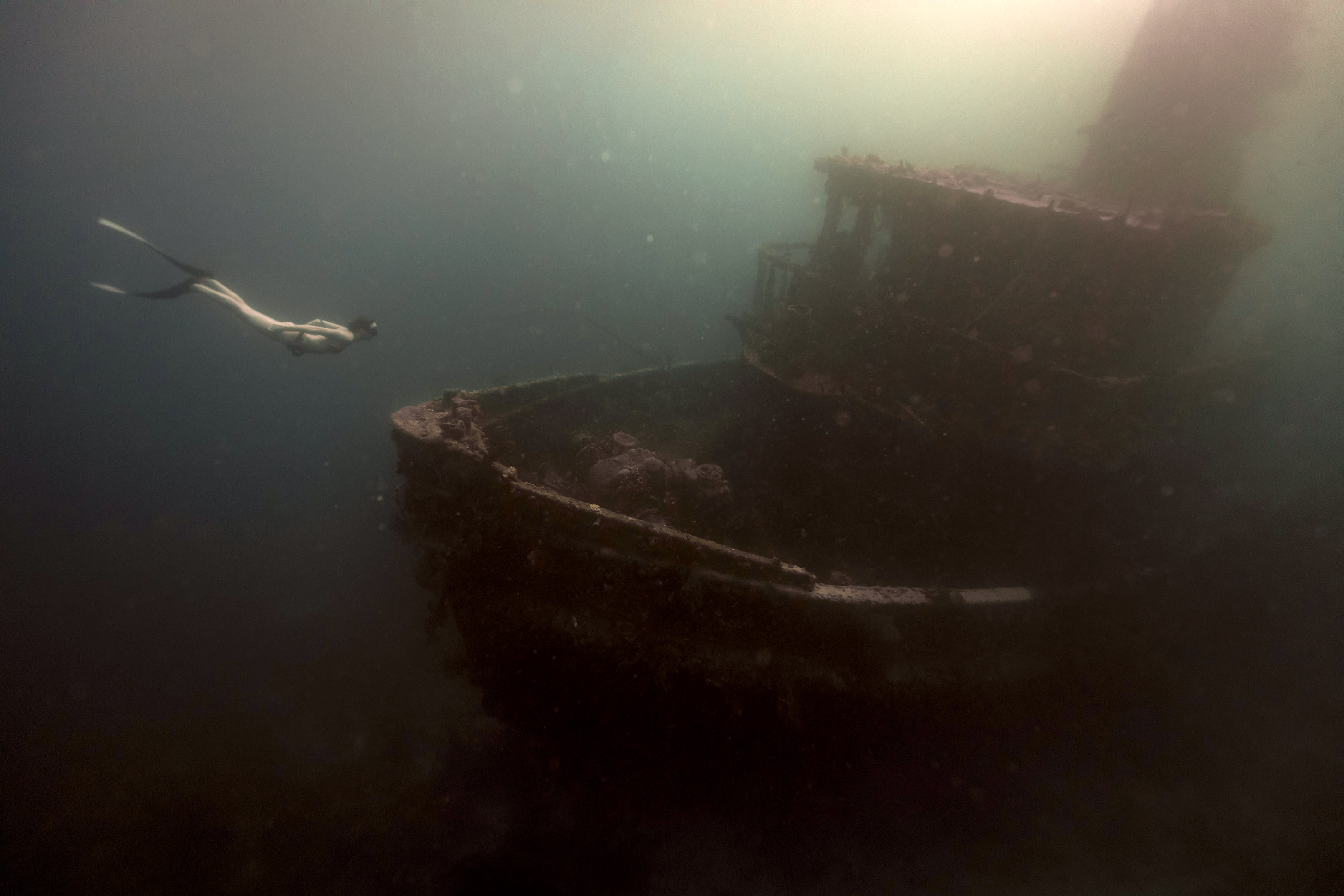 <p>A diver swims next to a shipwreck in the Caribbean. (Photo: Alex Voyer/Caters News) </p>