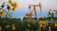 Oil drops as surprise U.S. stock build douses demand recovery hopes