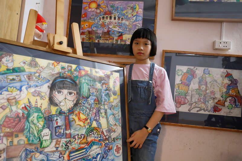A Vietnamese school girl draws paintings about the coronavirus disease (COVID-19) in Hanoi