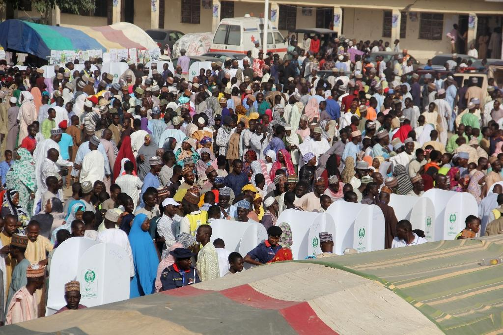 Voters in Maiduguri and throughout Nigeria queued to cast their votes in the delayed presidential election (AFP Photo/AUDU ALI MARTE)
