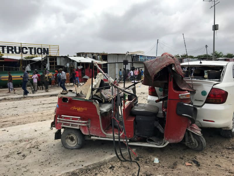 Wreckage of a rickshaw and a car destroyed are seen at the scene of an explosion in Mogadishu