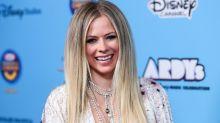 Avril Lavigne turns heads in plunging V-neck jumpsuit