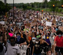 Photos show thousands of protesters demanding justice in Minneapolis after police killed George Floyd