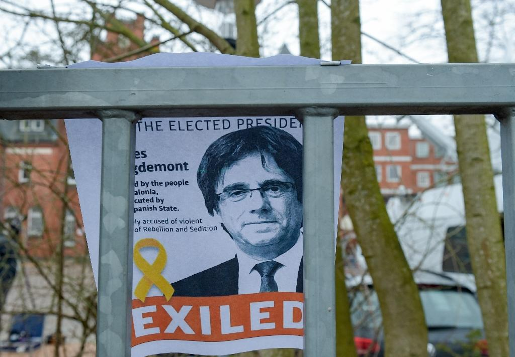 A portrait of Carles Puigdemont is attached behind the fence of the prison in Neumuenster, northern Germany, where the former Catalan president is being held pending a ruling on extradition to Spain. (AFP Photo/Axel Heimken)