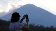 Menacing Bali volcano throws tourists' plans into jeopardy