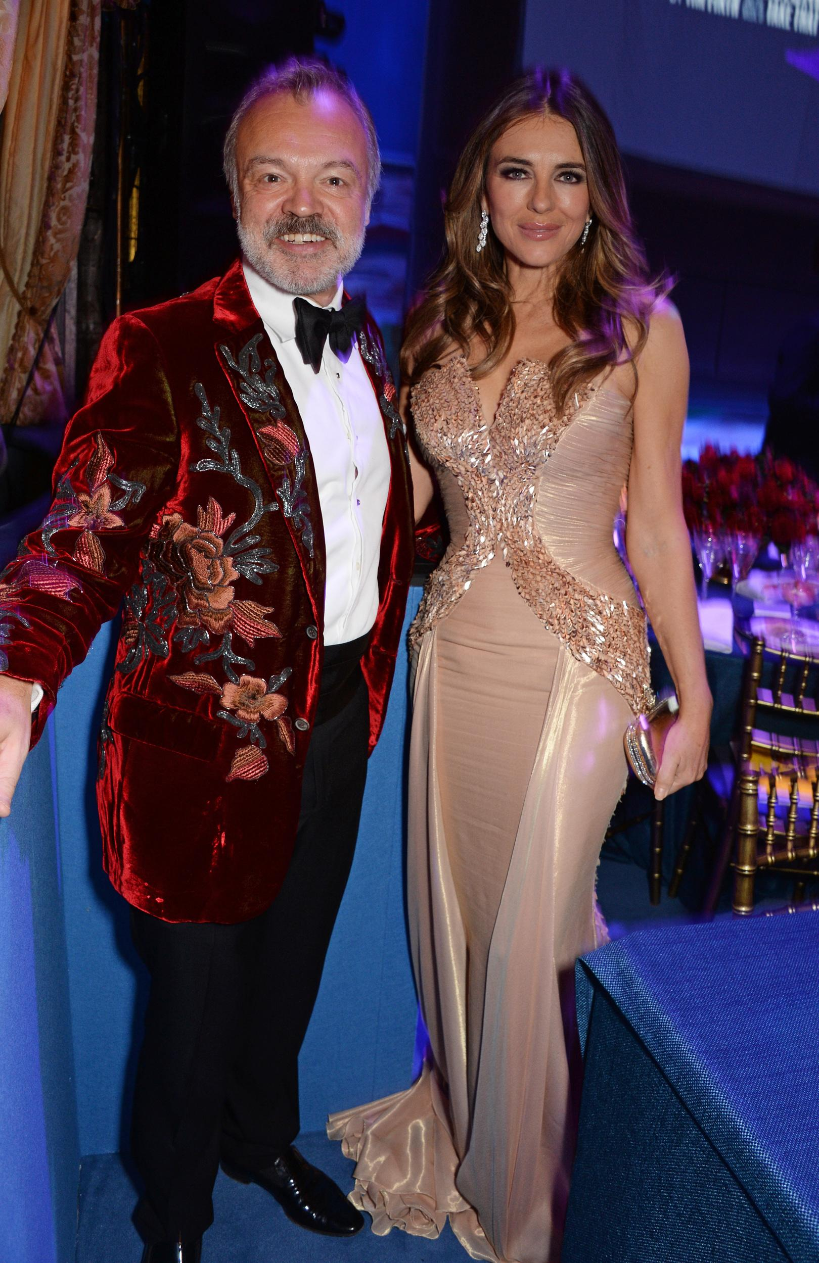 LONDON, ENGLAND - DECEMBER 04:    Graham Norton and Elizabeth Hurley attend  the Opening Night Gala of 'The Band' to benefit the Elton John AIDS Foundation supported by The Evening Standard at Theatre Royal Haymarket on December 4, 2018 in London, England.  (Photo by David M. Benett/Dave Benett/Getty Images)