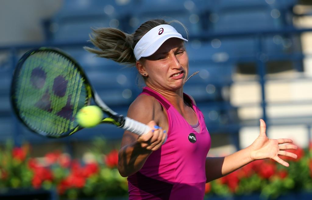 Daria Gavrilova of Australia hits a return during a WTA Dubai Open tournament match, on February 16, 2016