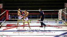 Thai boxing matches resume after lockdown, but audiences stay home