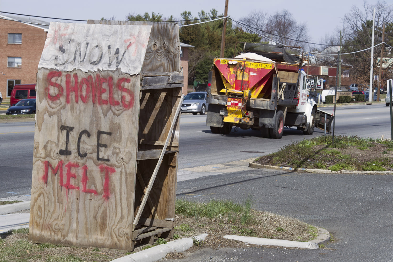 <p>A snow plow passes a sign at a garden supply store along in Alexandria, Va., Monday, March 13, 2017, in preparation of an East Coast snow storm. The mid-Atlantic is preparing for a late-season storm that is expected to bring significant snowfall to much of the region. Crews are already pretreating roads around the region in anticipation of snow that's expected to start falling Monday evening. (Cliff Owen/AP) </p>