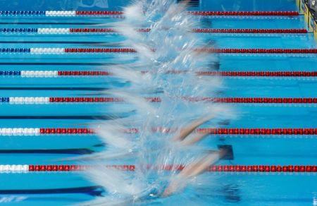 Swimmers dive in the pool to start their men's 100m freestyle heat during the U.S. Olympic swimming trials in Omaha, Nebraska, June 28, 2012. REUTERS/Jeff Haynes