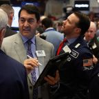Wall St falls as Fed minutes send bond yields higher