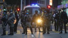Hong Kong protester arrested on suspicion of stabbing police