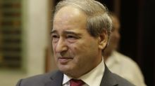 Syria's Assad names new FM to replace late diplomat