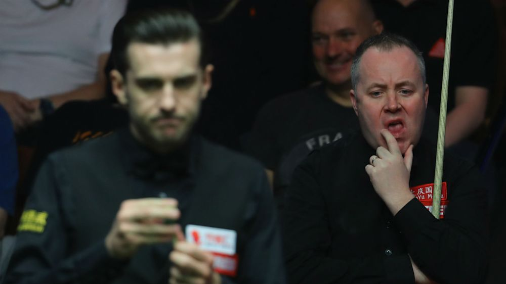 Selby roars back to beat Higgins in Crucible final