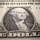 Dollar trades near recent lows; kiwi climbs