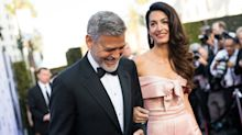 Amal Clooney pretty in pink Prada for red carpet awards with husband George