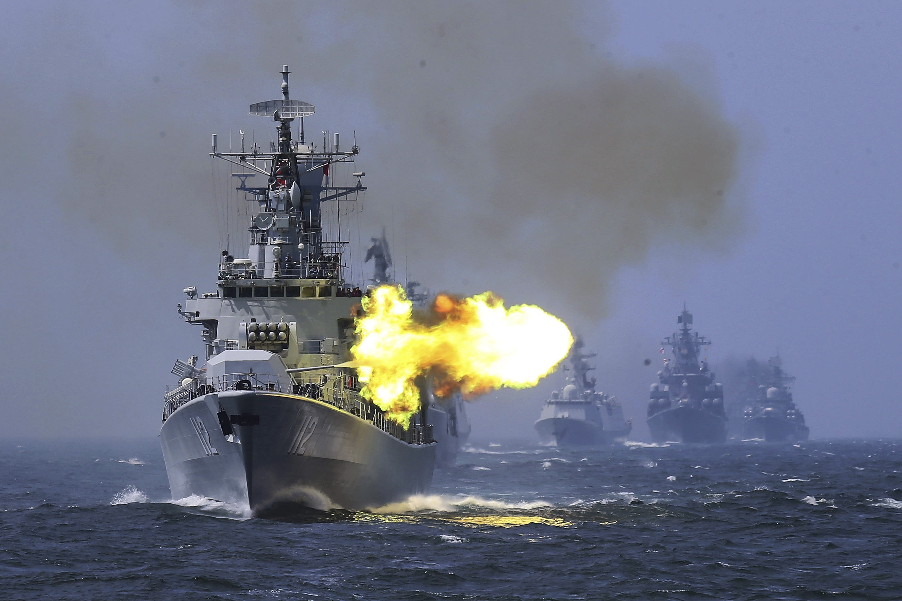 "FILE - In this file photo taken Saturday, May 24, 2014, China's Harbin (112) guided missile destroyer takes part in a week-long China-Russia ""Joint Sea-2014"" navy exercise at the East China Sea off Shanghai, China. A Russian naval task force has arrived in the northern Chinese port of Qingdao ahead of joint naval exercises that reinforce the growing bond between Beijing and Moscow. (AP Photo)"