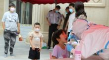 New virus cluster spreads to five Chinese regions