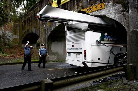 Bus driver chooses GPS over gigantic warning sign, plows into overpass