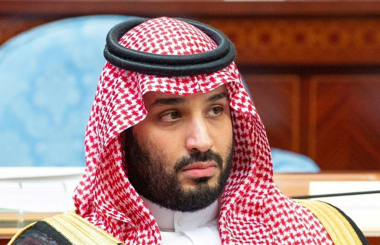 Saudi Crown Prince Mohammed bin Salman has pushed through a raft of modernising reforms while also facing criticisms over the kingdom's rights record (AFP Photo/HO)