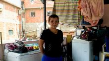 Economic crisis cuts swathe through Venezuela society