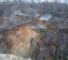 Tennessee flooding: 'Unprecedented' floods make homes slide into river