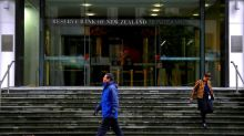 New Zealand central bank holds rates but hints at further easing