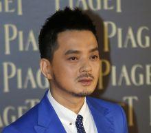 Hong Kong pop singer, activist arrested on corruption charge