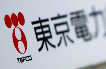A TEPCO logo is pictured on a sign showing the way to the venue of the company's annual shareholders' meeting in Tokyo