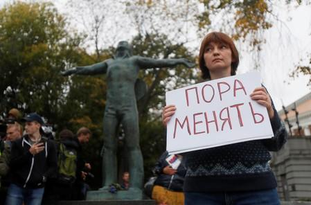 A woman takes part in a protest demanding authorities to allow opposition candidates to run in the upcoming local election and release people arrested for participation in opposition rallies, in Moscow