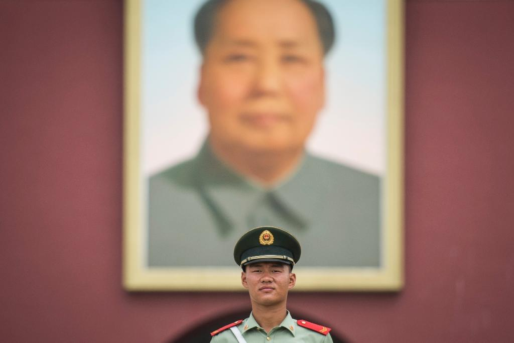 Mao Zedong's corpse still lies in state in the centre of Beijing, watched over by a giant portrait hanging on the Forbidden City in Tiananmen Square (AFP Photo/Fred Dufour)