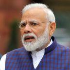 India's Modi extends free foodgrain program for poor battling coronavirus