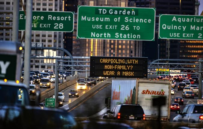 "BOSTON, MA - NOVEMBER 24: Traffic on I- 93 South in Boston is stalled by South Bay in Boston on Nov. 24, 2020, two days before Thanksgiving. A sign reads ""carpooling with non-family? Wear a mask."" (Photo by Stan Grossfeld/The Boston Globe via Getty Images)"