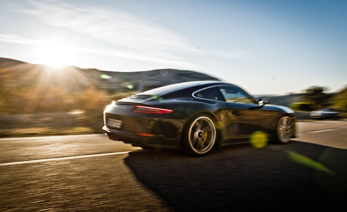 """<p>Basically <a href=""""https://www.caranddriver.com/reviews/a16767185/2018-porsche-911-gt3-with-touring-package-first-drive-review/"""" rel=""""nofollow noopener"""" target=""""_blank"""" data-ylk=""""slk:a wingless, more civilized 911 GT3"""" class=""""link rapid-noclick-resp"""">a wingless, more civilized 911 GT3</a>, the 2018 <a href=""""https://www.caranddriver.com/porsche/911-gt3-gt3-rs"""" rel=""""nofollow noopener"""" target=""""_blank"""" data-ylk=""""slk:Porsche 911 GT3 Touring"""" class=""""link rapid-noclick-resp"""">Porsche 911 GT3 Touring</a> opens our list with a wide-open-throttle sound level of 95 decibels, comparable to the sound a subway train makes from 200 feet away. These glorious decibels are blasted into the cabin by a 500-hp 4.0-liter flat-six that revs to 9000 rpm.</p>"""