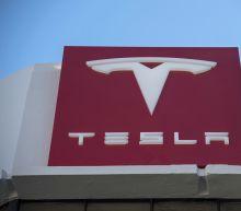 Tesla unveils 'lower-cost' Model 3